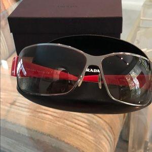 Authentic Prada unisex sunglasses in excellent con